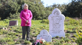 Family History Group author Marilynne Cullen at Birubi Point cemetery, which is the focus of a new book that was approved for a council grant. Pictures: Ellie-Marie Watts