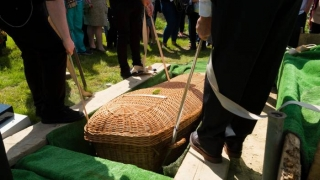 wicker casket coffin lowering green natural 320px